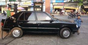 Cần bán xe Peugeot 308, xe màu đen, còn mới giá 80 triệu tại Tp.HCM