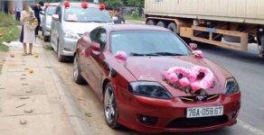 Cần bán Hyundai Tuscani 2.0MT năm 2005, màu đỏ, xe nhập xe gia đình giá cạnh tranh giá 365 triệu tại Đà Nẵng