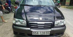 Cần bán gấp Hyundai Trajet 2004, màu đen số tự động, giá chỉ 320 triệu giá 320 triệu tại Cần Thơ