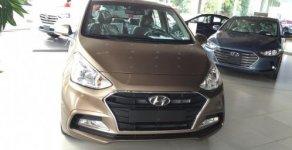 Bán xe I10 Sedan màu vàng cát, hỗ trợ trả góp, 120tr nhận xe giá 415 triệu tại Tp.HCM