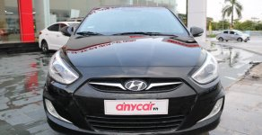 Cần bán xe Hyundai Accent 1.4 MT Sedan đời 2014, màu đen, nhập khẩu nguyên chiếc giá 424 triệu tại Hà Nội