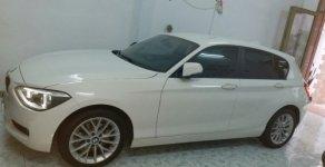 Cần bán BMW 1 Series 1.6 AT sản xuất 2013, màu trắng  giá 875 triệu tại Tp.HCM
