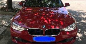 Cần bán BMW 3 Series 320i sản xuất năm 2013, màu đỏ, nhập khẩu, giá tốt giá 900 triệu tại Tp.HCM