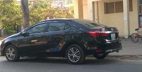 Bán xe Toyota Corolla L 1.8 AT đời 2014, màu đen giá 650 triệu tại Tp.HCM