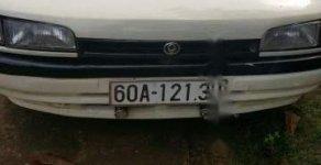Cần bán xe Mazda 323 MT năm 1995, màu trắng, mọi chức năng sử dụng bình thường giá 52 triệu tại Bình Dương