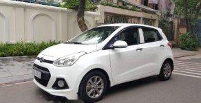 Gia đình cần bán xe Hyundai Grand i10 sản xuất 2014, Đk tháng 12/2014, màu trắng giá 286 triệu tại Hà Nội