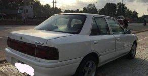 Bán Mazda 323 đời 1995, màu trắng, giá tốt giá 59 triệu tại Bình Dương