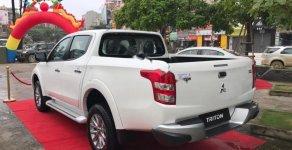 Bán Mitsubishi Triton 4x2 AT Mivec sản xuất 2018, màu trắng giá 685 triệu tại Hà Nội