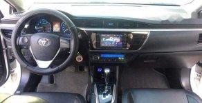 Cần bán Toyota Corolla Altis 1.8G CVT sản xuất 2014, màu trắng giá 630 triệu tại Vĩnh Long
