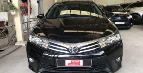 Bán xe Toyota Altis 1.8 tự động, sản xuất 2016, màu đen, máy xăng giá 725 triệu tại Tp.HCM
