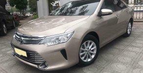 Bán xe Toyota Camry 2.0,đời 2016, số tự động, màu vàng cát, full option giá 877 triệu tại Tp.HCM