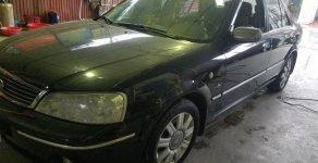 Bán Ford Laser số tự động đời 2004, màu đen giá 225 triệu tại Nam Định