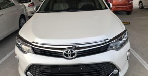 Bán ô tô Toyota Camry 2.0E AT model 2019, màu trắng giá 980 triệu tại Tp.HCM