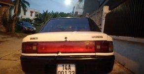 Cần bán gấp Mazda 323 đời 1996, màu trắng, nhập khẩu nguyên chiếc giá 55 triệu tại Quảng Ninh