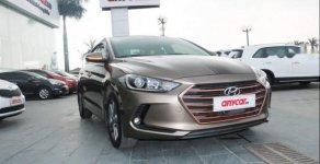 Bán Hyundai Elantra 1.6AT năm 2016, màu vàng cát giá 609 triệu tại Hà Nội