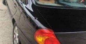 Cần bán lại xe Kia Spectra 2003, màu đen, 125 triệu giá 125 triệu tại Hà Giang
