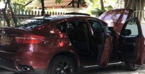 Chính chủ bán BMW X6 sản xuất 2009, màu đỏ giá 800 triệu tại Tp.HCM
