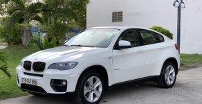 Cần bán xe BMW X6 3.0 Sản xuất 2012 đăng ký 2013, màu trắng, nhập Mỹ, cam kết bao kiểm tra hãng giá 1 tỷ 450 tr tại Tp.HCM