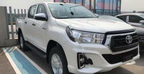 Bán Toyota Hilux 2.4E 4x2AT 2018 màu trắng giá 695 triệu tại Hà Nội
