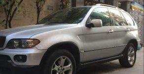 Chính chủ bán xe BMW X5 đời 2007, màu bạc giá 400 triệu tại Tp.HCM