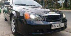 Chính chủ bán xe Daewoo Magnus đời 2004, màu đen, nhập khẩu giá 180 triệu tại Tp.HCM