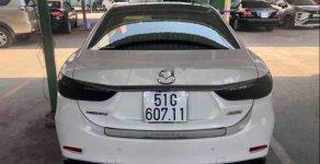 Cần bán gấp Mazda 6 2.0 Premium 2018, màu trắng chính chủ giá 910 triệu tại Tp.HCM