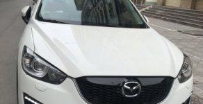 Bán xe Mazda CX 5 2.0 AT sản xuất năm 2013, màu trắng giá 700 triệu tại Hà Nội