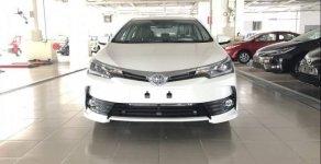 Bán ô tô Toyota Corolla Altis sản xuất năm 2019, màu trắng, giá tốt giá 900 triệu tại Tp.HCM