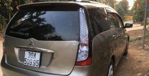 Gia đình cần bán Mitsubishi Grandis 2.4 AT sản xuất năm 2008, màu vàng giá 420 triệu tại Hà Nội