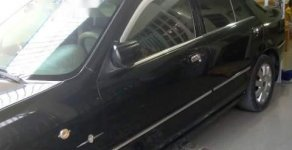Bán ô tô Ford Laser đời 2005, màu đen số tự động giá 215 triệu tại Đồng Nai