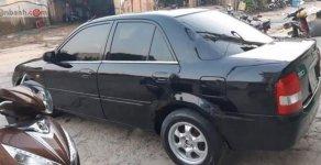 Bán gấp Mazda 323 Classic GLX sản xuất năm 2004, màu đen   giá 145 triệu tại Kon Tum