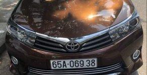 Bán ô tô Toyota Corolla altis 2.0V AT đời 2015, màu nâu xe gia đình giá 710 triệu tại Cần Thơ