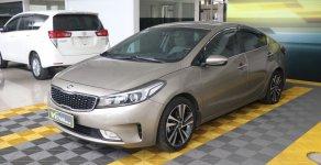 Bán xe Kia Cerato 1.6AT năm 2018, màu vàng, giá tốt giá 596 triệu tại Hà Nội