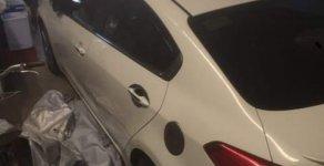 Cần bán lại xe Kia K3 2.0 năm 2015, màu trắng, xe đẹp giá 550 triệu tại Tp.HCM