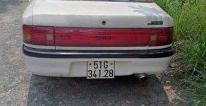 Bán Mazda 323 1995, màu trắng, nhập khẩu giá 50 triệu tại Tp.HCM