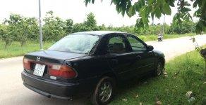 Bán Mazda 323 đời 1998, màu xanh đen bản đủ giá 75 triệu tại Bình Dương