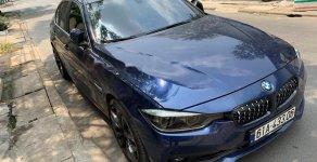 Cần bán BMW 3 Series 320i 2015, màu xanh lam, nhập khẩu giá 1 tỷ 100 tr tại Bình Dương