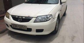 Bán Mazda 323 năm sản xuất 2002, màu trắng, nhập khẩu nguyên chiếc  giá 119 triệu tại Hà Nội