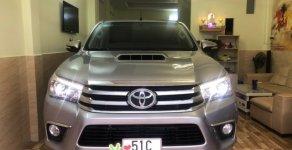 Bán Toyota Hilux 3.0G AT 2 cầu năm sản xuất 2015, màu bạc, nhập khẩu giá 639 triệu tại Tp.HCM