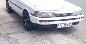 Bán Toyota Camry đời 1999, màu trắng, nhập khẩu giá 75 triệu tại Bình Dương