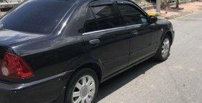 Cần bán Ford Laser đời 2002, màu đen, xe nhập chính chủ, giá 180tr giá 180 triệu tại Bạc Liêu