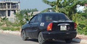 Cần bán gấp Daewoo Lanos sản xuất 2002, màu đen, giá chỉ 54 triệu giá 54 triệu tại Bắc Giang