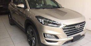 Bán Hyundai Tucson 1.6 AT Turbo đời 2019, màu vàng, giá 910tr giá 910 triệu tại Hà Nội