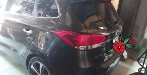Cần bán xe Kia Rondo đời 2016, màu nâu xe gia đình giá 509 triệu tại Bình Dương