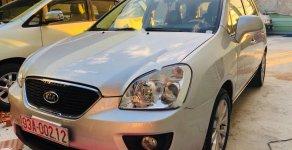 Cần bán gấp Kia Carens 2.0MT đời 2010, màu bạc giá 290 triệu tại Bình Dương