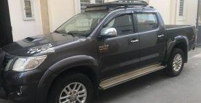 Cần bán gấp Toyota Hilux G đời 2015, màu xám, nhập khẩu nguyên chiếc số sàn, giá tốt giá 570 triệu tại Tp.HCM