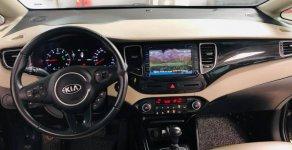 Cần bán lại xe Kia Rondo đời 2015, màu nâu số tự động, giá tốt giá 586 triệu tại Tp.HCM