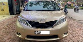 Cần bán Toyota Sienna LE 2.7 đời 2010, màu vàng, nhập khẩu giá 1 tỷ 50 tr tại Hà Nội