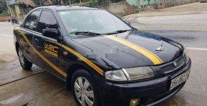 Bán Mazda 323 đời 2000, màu đen, nhập khẩu nguyên chiếc giá 76 triệu tại Nghệ An