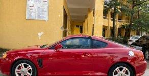 Bán xe Hyundai Tuscani 2.0AT năm 2004, màu đỏ, nhập khẩu giá 302 triệu tại Hà Nội